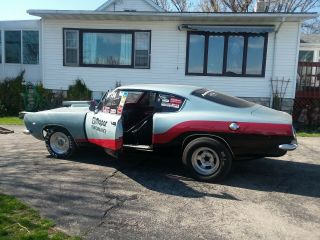 1967 plymouth barracuda car.  Set up for drag racing.  5 point harness,  roll cage. 2