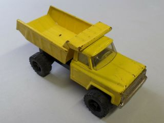 "Vintage Pressed Steel Chevy Dump Truck Yellow Made In Japan Approx 8 1/2 "" Long"