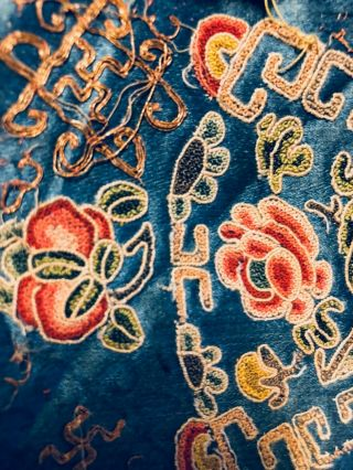An antique embroidered red silk Chinese robe 10