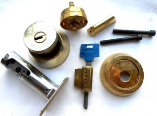 Mul - T - Lock High Security Lock Cylinders,  Parts.  1 Key Work In 2 Cylinders