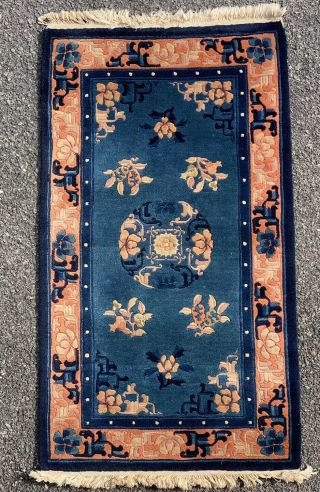 C1940 Chinese Peking Blue Ground Rug.  Floral Salmon Border With Center Medallion