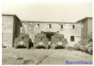 Us M4 Sherman Tanks Lined Up By Building In Captured German Town