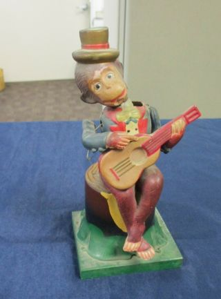 Vintage Celluloid & Tin Litho Wind Up Monkey On A Stump Playing Guitar